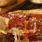 slice of deep dish pizza from Lou Malnati's in Addison