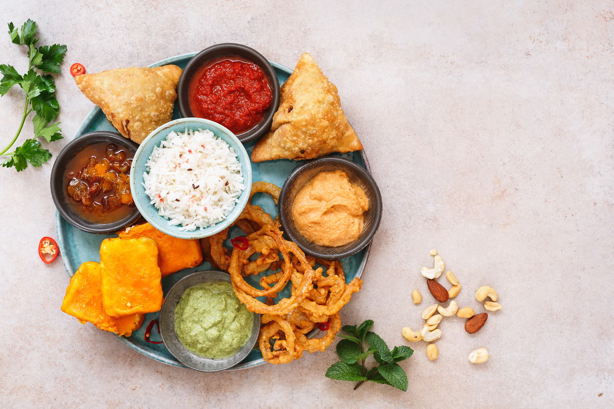 Overhead view of Indian vegetarian thali on a round plate.