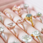 rings-with-precious-stones-in-pink-satin-jewelry-case
