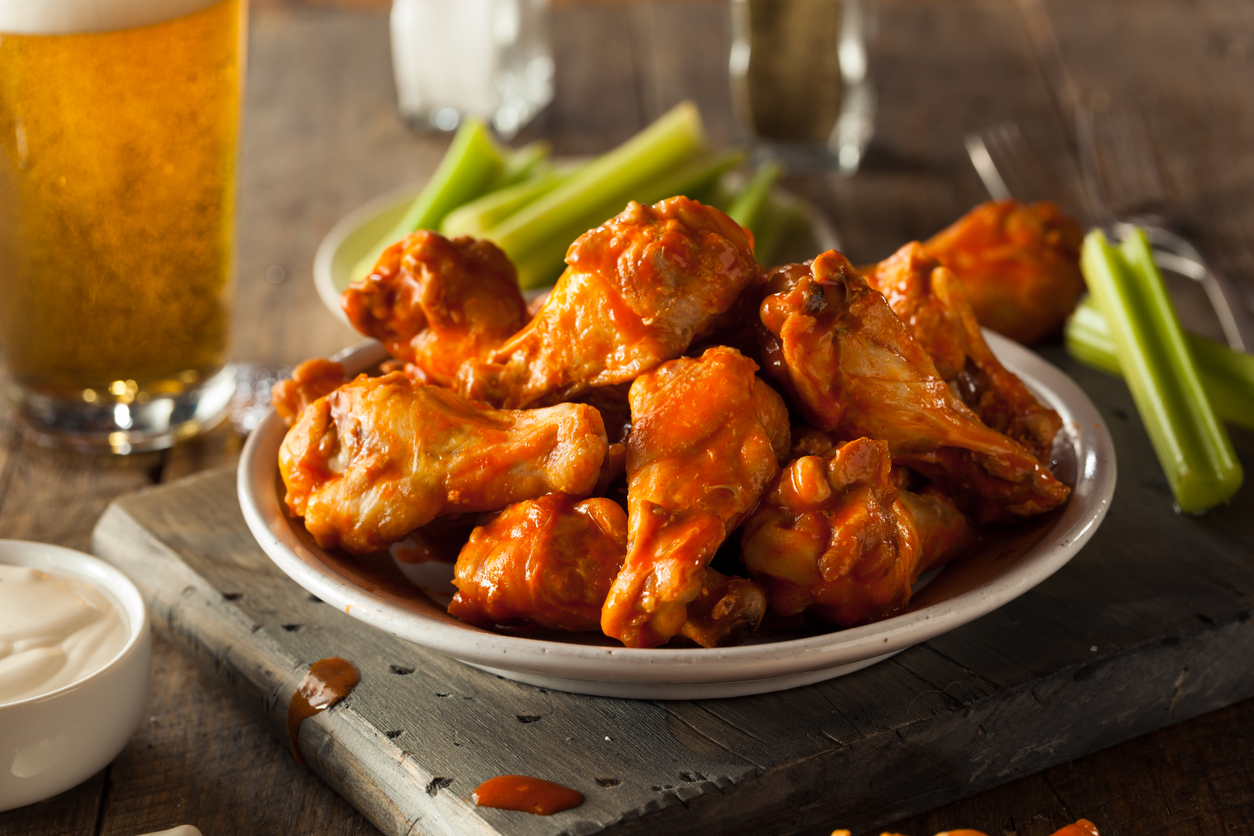 Spicy Homemade Buffalo Wings with celery and dip